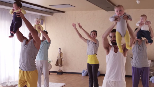 An American woman takes a yoga class with Swedish men and their babies.
