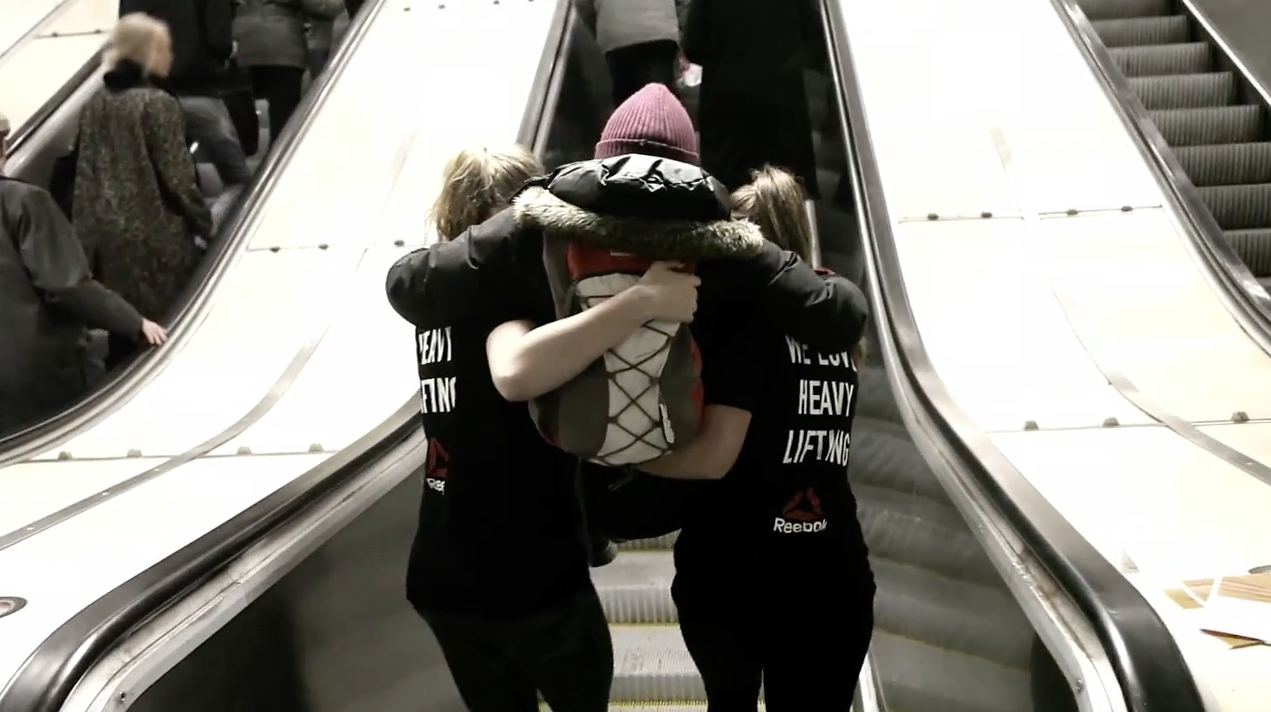 people on escalators. when the escalators died in stockholm\u0027s subway, reebok was there to give people a lift on