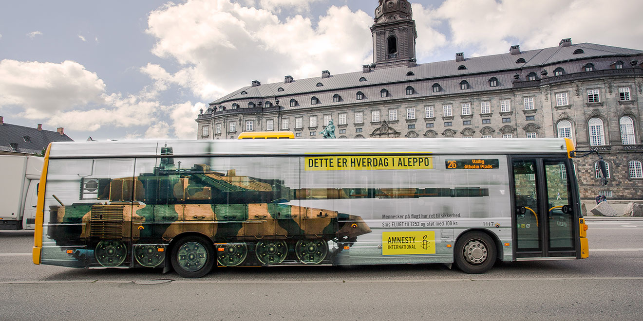 The Wrap Institute >> This Remarkable Bus-Wrap Ad Brings the Syrian War to the Streets of Copenhagen – Adweek