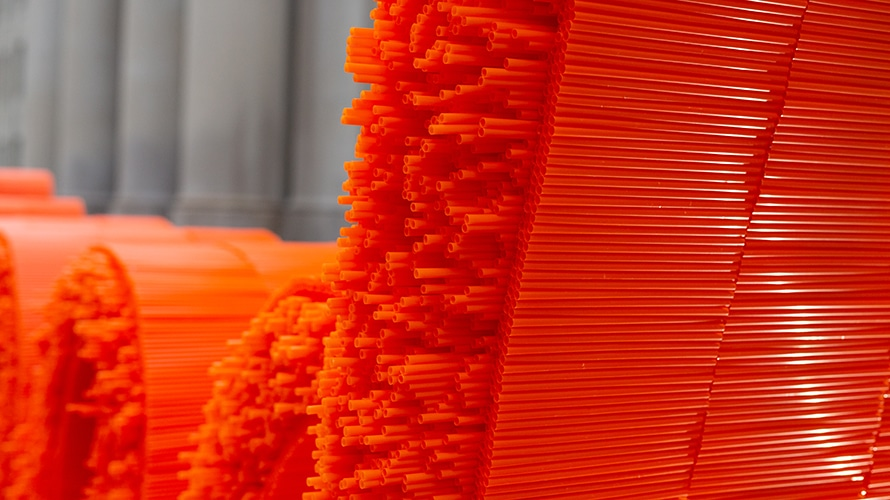 The straws of the sculpture are shown up close.