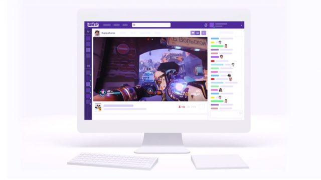 A desktop computer; on the screen is a livestream from Twitch