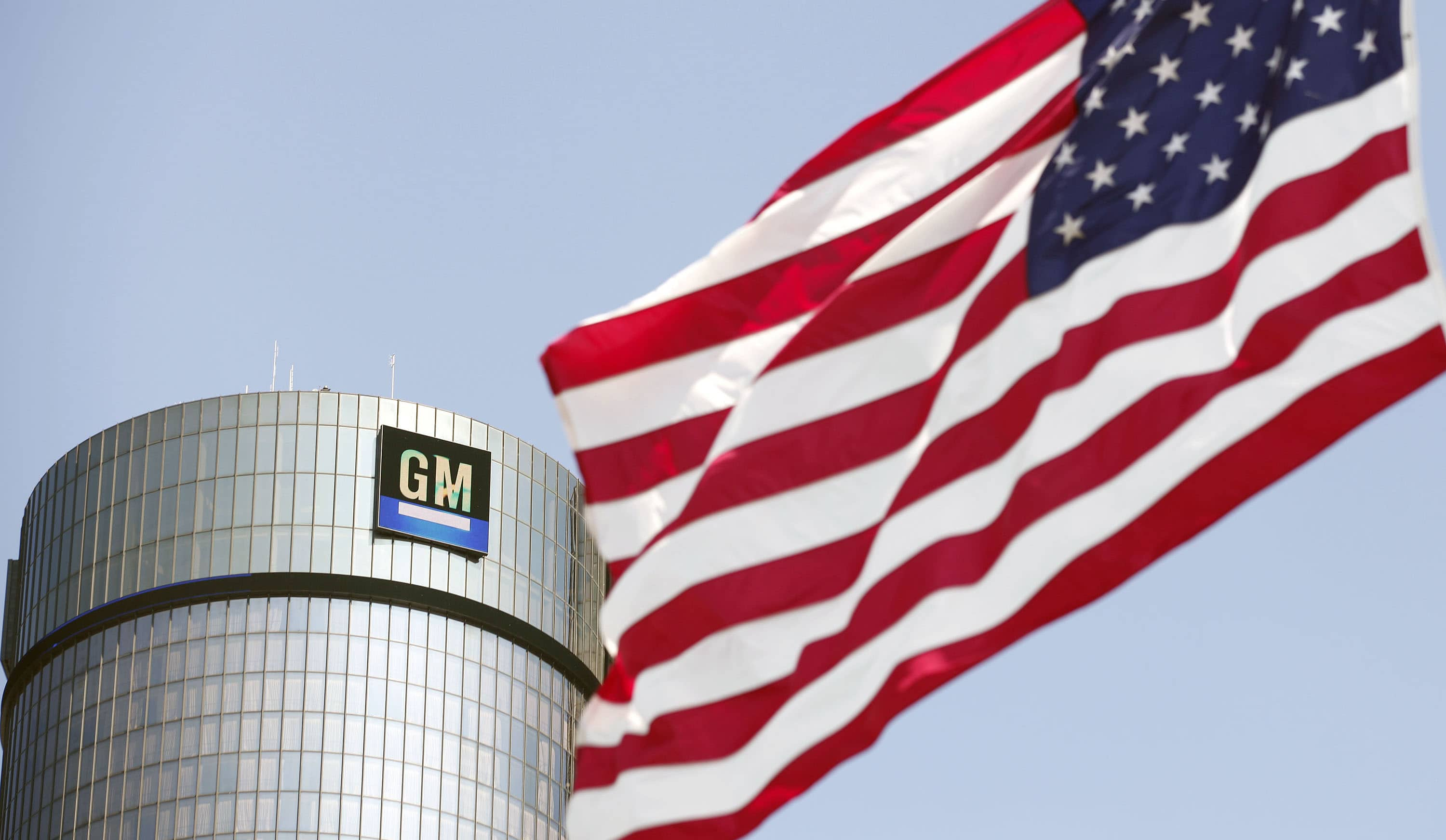 GM headquarters next to an American flag