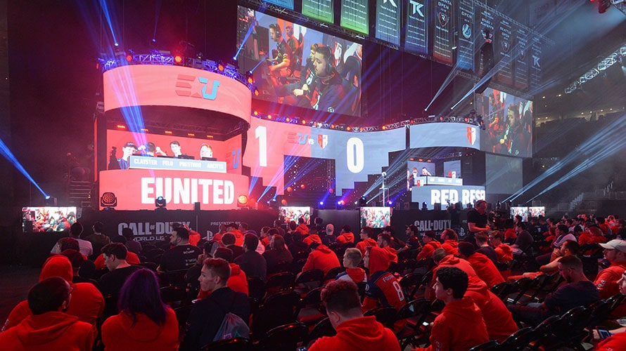 At an Esports events, people crowd around a stage