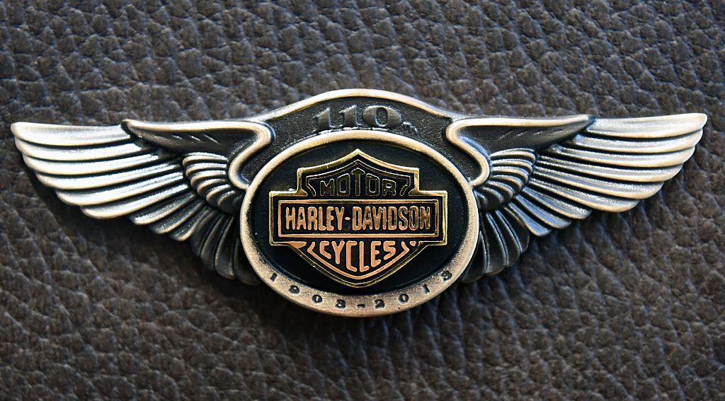Harley-Davidson logo in metal on leather background