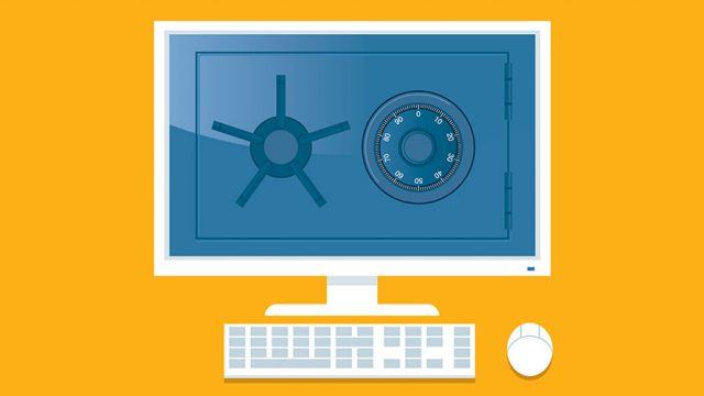 a desktop computer; orange background; a safe on the screen of the computer