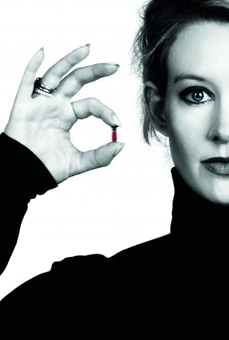 Elizabeth Holmes of Theranos holds a small vial of blood