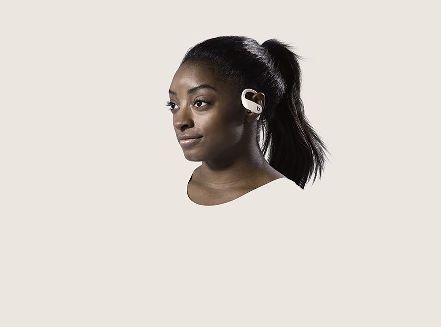 Simone Biles wears Powerbeats Pro wireless headphones.