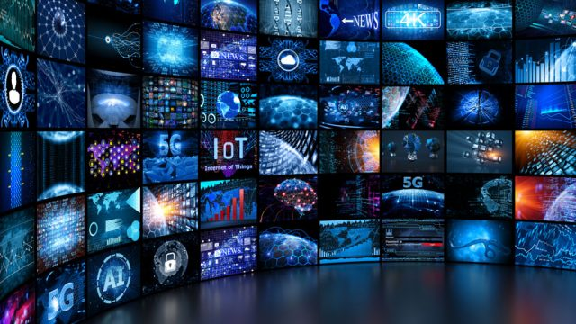 A massive screen has dozens of smaller screens displaying various broadcast mediums