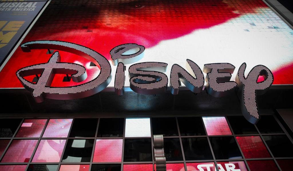 Disney signage below a screen