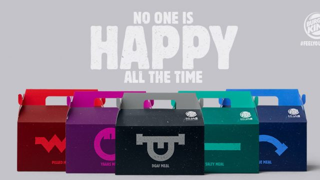 """different colored Burger King Boxes are lined up; The top of the image says """"No one is Happy All the Time"""""""