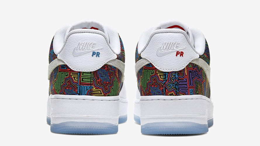 """Back of Nike Air Force on next to the Nike logo is blue """"PR"""" on the left shoe and a red """"PR"""" on the right shoe"""