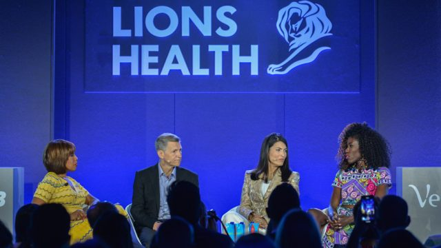 four marketers are seen talking on a stage at an event that says Lions Health at Cannes