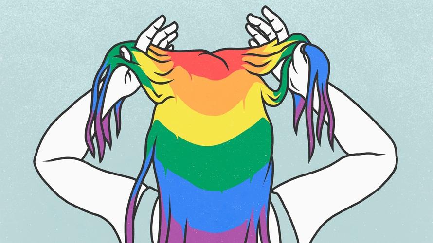 A person with rainbow hair fixes their hair