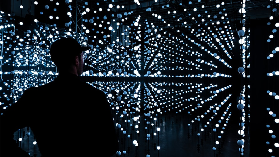 Man experiencing Google and Sonos sound lounge light exhibit