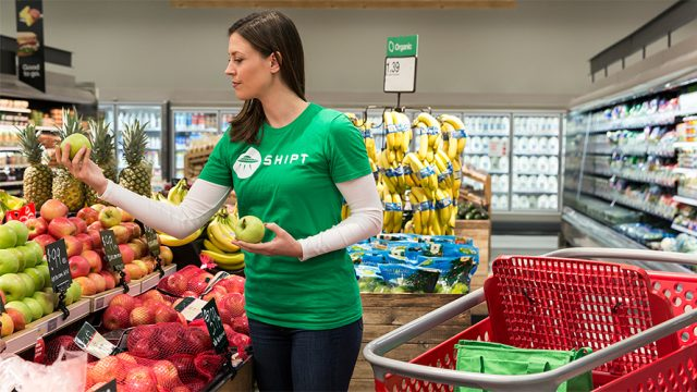Woman grocery shopping at Target for story on same-day delivery