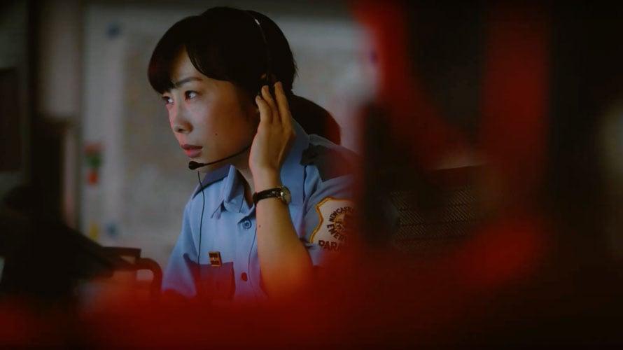 911 operator in a still from Jo Motoyo's film Midnight