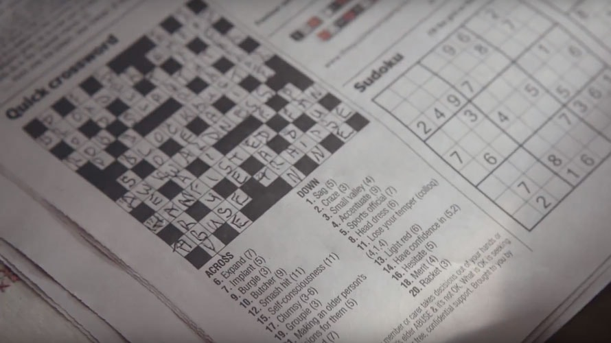 A crossword puzzle from a newspaper with sudoku next to it