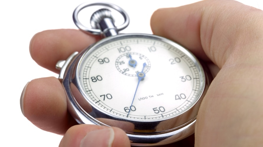Hand holding a stopwatch currently at 60 seconds