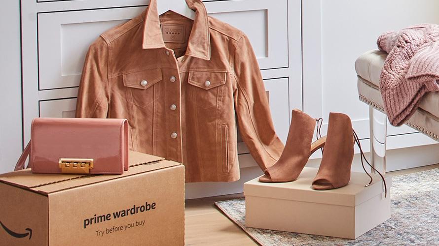 Amazon fashion set on the floor, amazon box, purse, jacket, heels
