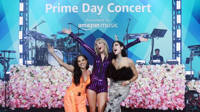 Picture of Becky G, Taylor Swift, Dua Lipa on stage at Amazon Prime Day Concert.