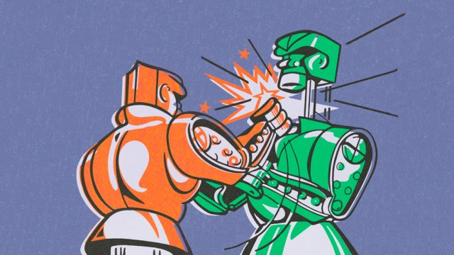 An orange robot fighting a green robot