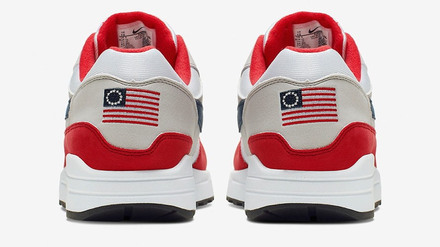 White and red shoes with American flag on back.