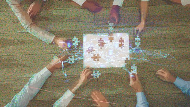 Puzzle in the center; Ten hands placing pieces into the unfinished puzzle