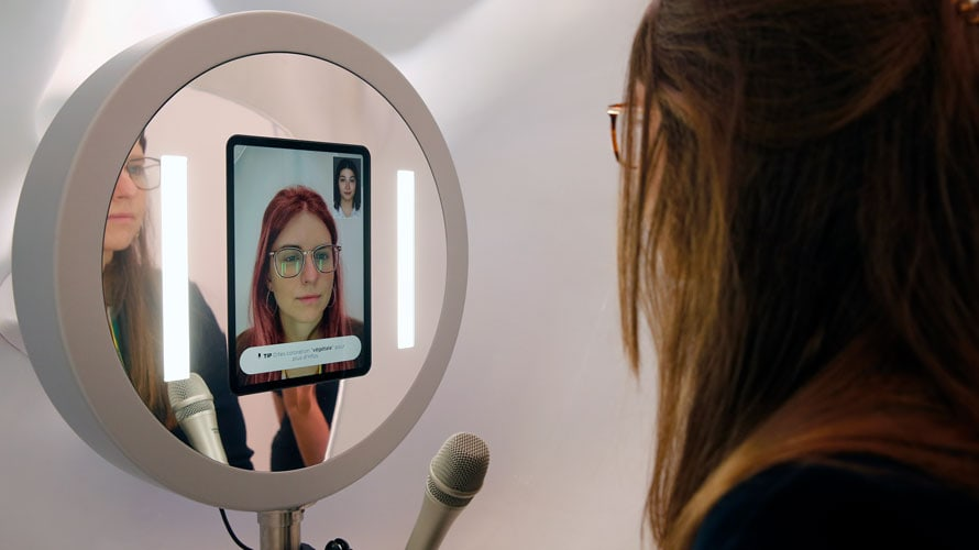 A woman using L'Oréal's virtual hair try-on experience