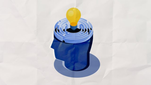 A blue head with a yellow lightbulb popping out.