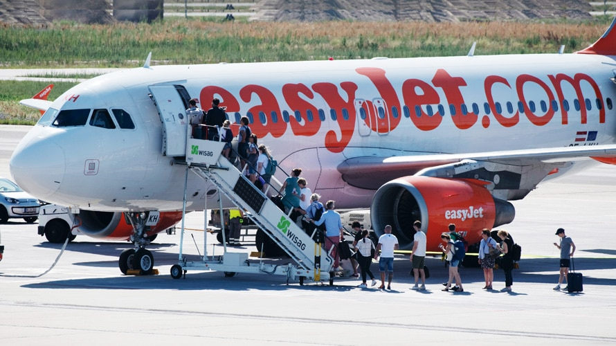 People boarding easy jet plane