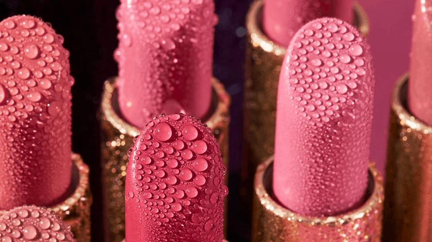 pink lipsticks covered in dewey water