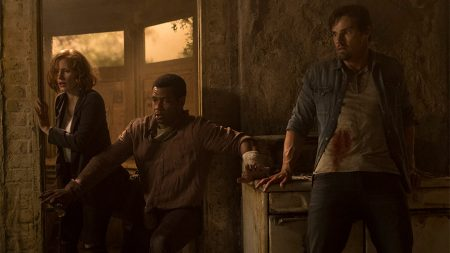 Actors Jessica Chastain, Isiah Mustafa the old spice guy and James Ransone looking worried in a still from the movie It Chapter Two