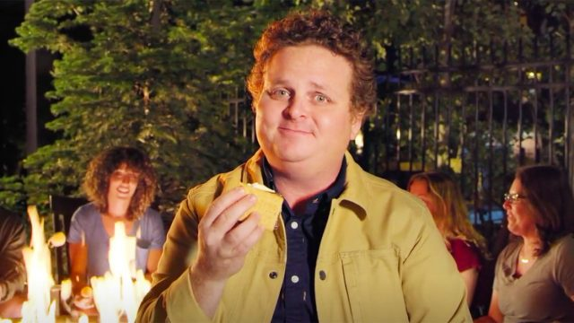 Actor Patrick Renna holds a s'more