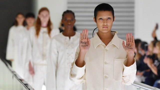 gucci milan fashion week runway protest straitjacket mental health