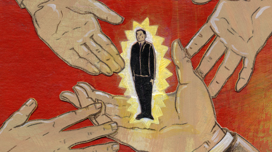 hands holding a man in a black suit who is glowing