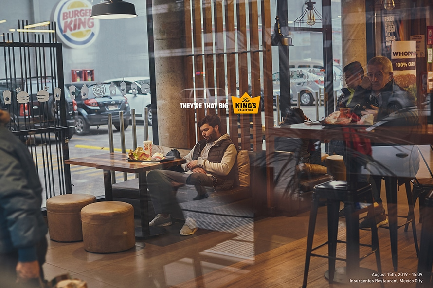 A man naps in his booth at Burger King.