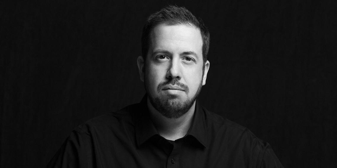 black and white headshot of Derek Fridman