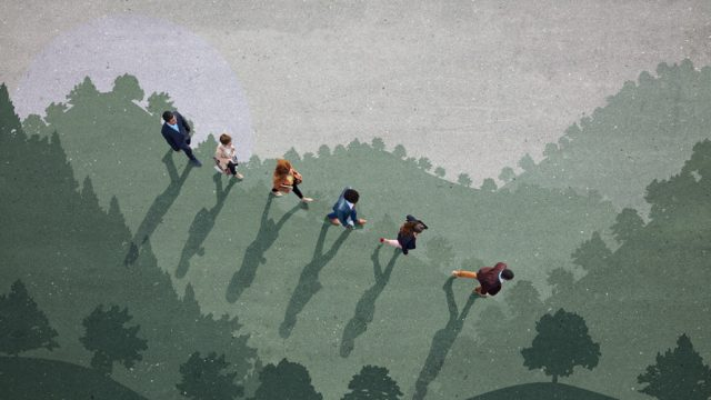 Overhead view of people walking over shadows of trees and hills