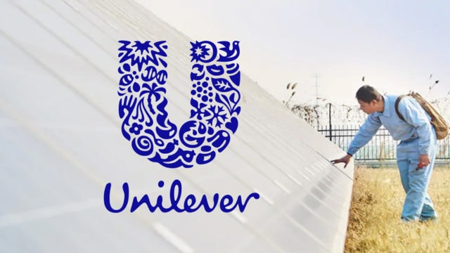 Unilever logo with man touching solar panels