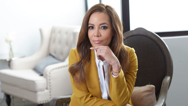 Sunny Hostin wearing a yellow jacket over a white shirt