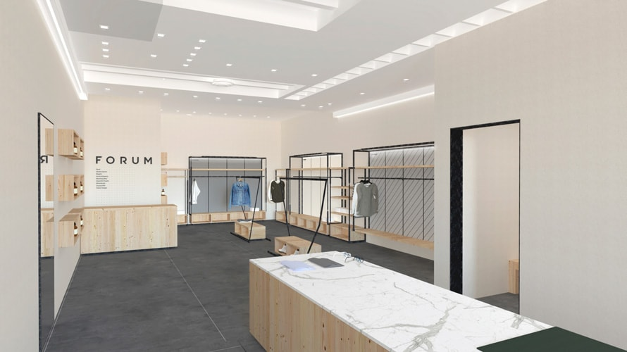 Clothing racks and a counter in what will be the Forum space