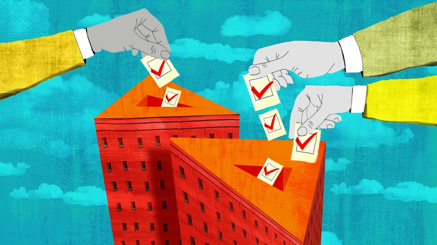 hands putting ballots into ballot boxes