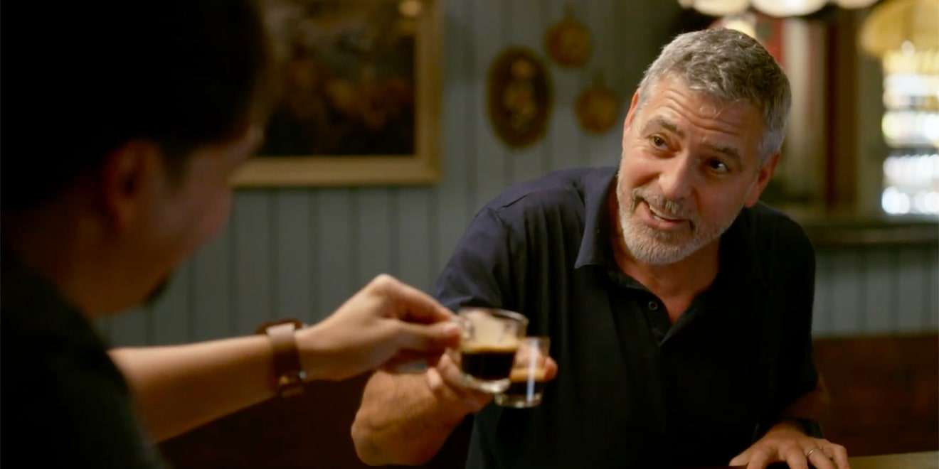 lin-manuel miranda and george clooney having coffee