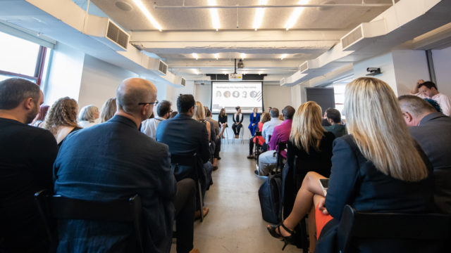 audience members listen to speakers at Adweek's Fastest Growing Agencies panel