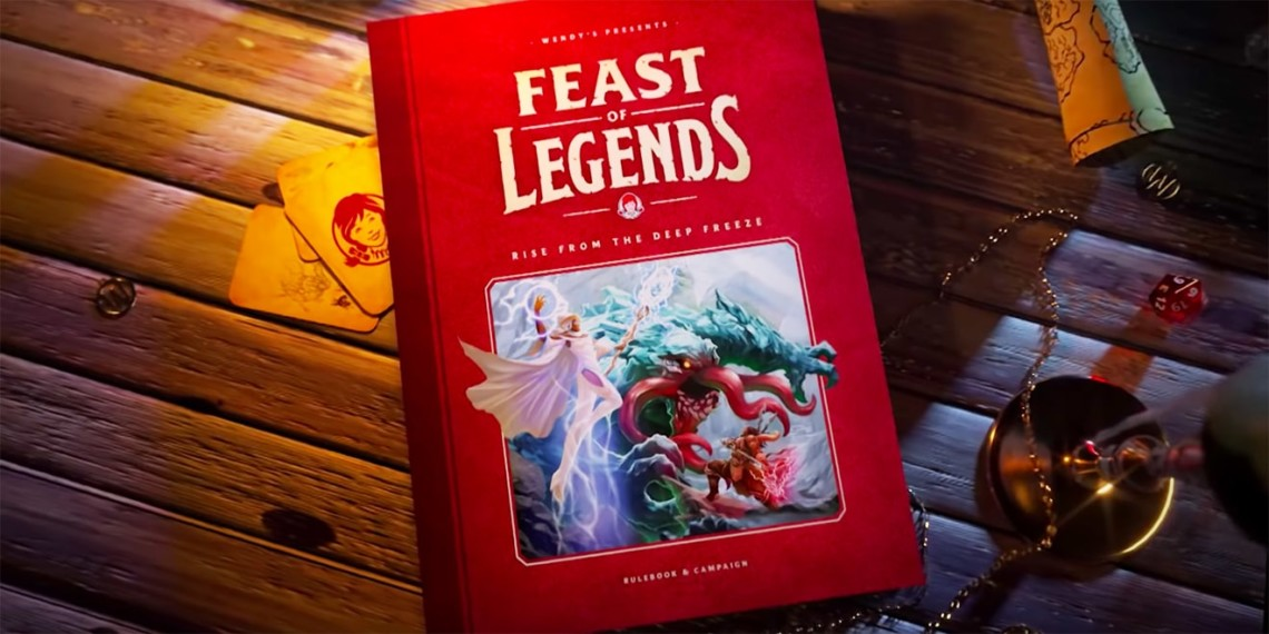 A role playing game book for Feast of Legends sits on a wooden table