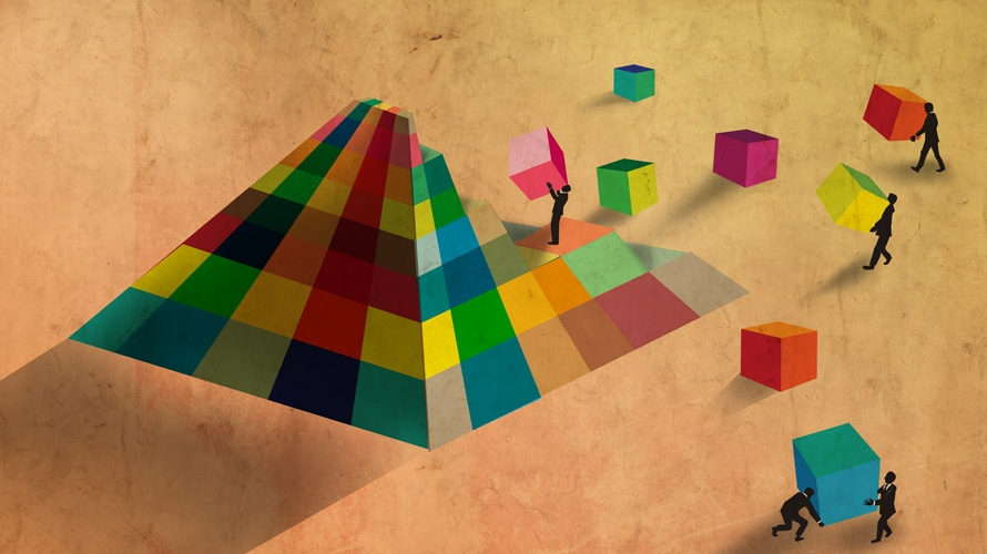 a colorful pyramid being built piece by piece