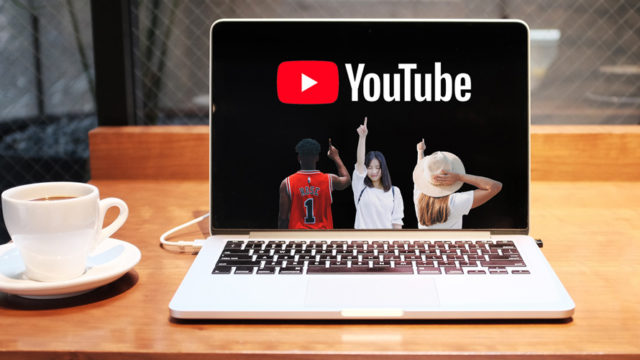 Gen Z inside a laptop screen pointing at Youtube Logo