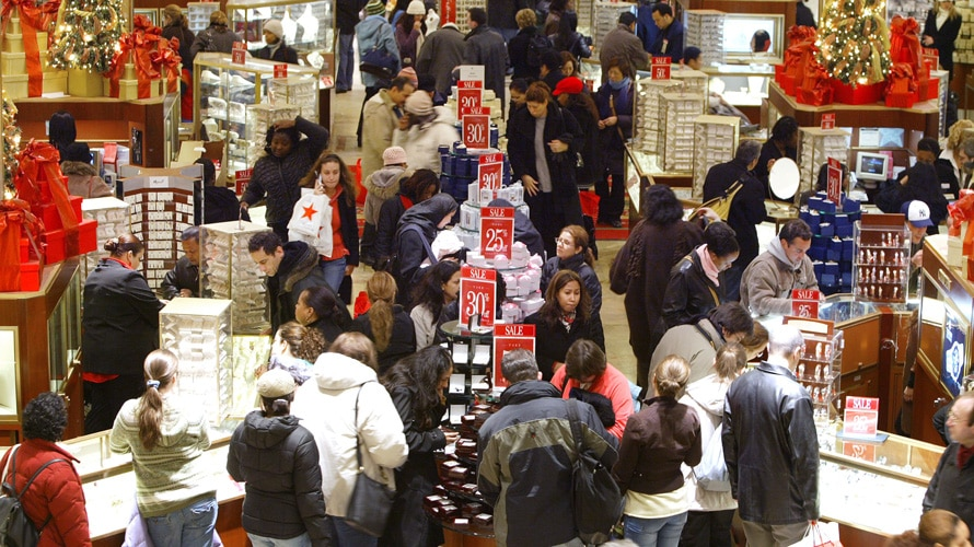 people holiday shopping in a crowded store