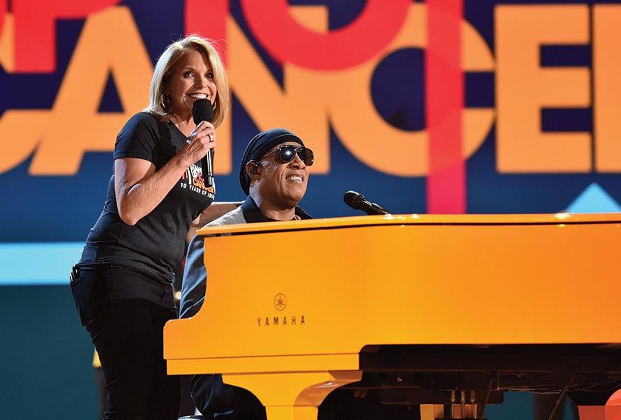 Katie Couric and Stevie Wonder onstage
