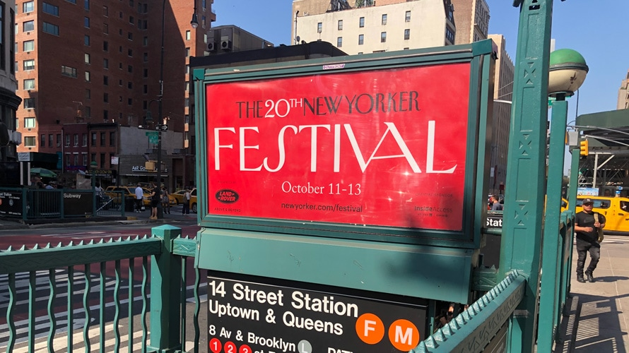 Subway station entrance with an advertisement for the 20th New Yorker festival
